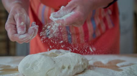 hamur : Adding the flour to make a prefect bought . Slow motion close up RAW footage of a baker woman adding the flour to make a perfect bough for a home made bread.