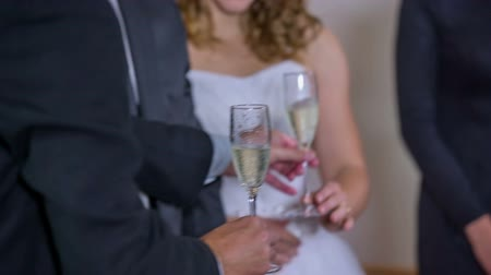 отель : After the wadding flows the toast with champagne. Close up RAW footage of a best man picking up the glasses with champagne to taste on the good married.