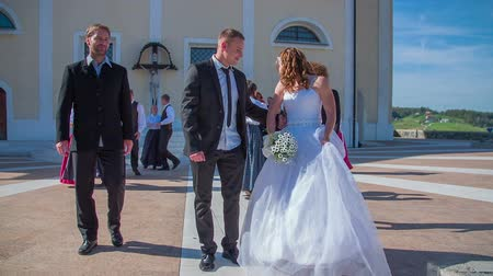 evli : SENTJUR SLOVENIA  OCTOBER 2014: Slow motion total RAW footage of a just married couple do the final thing to throw a bouquet on a sunny day.