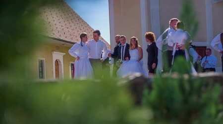 templombúcsú : SENTJUR SLOVENIA  OCTOBER 2014: Slow motion RAW footage of a young couples dancing in front of the church  on a sunny day in the middle of a country side.