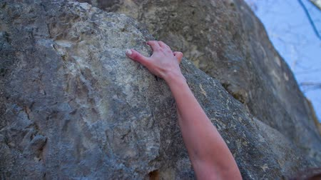 alpinista : This is an arm filmed during the climbing on the big rock.  He is a very experienced climber which has a big wish to rich the top of this rock on a countryside.