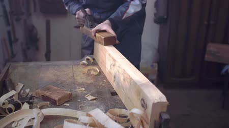 oyma : Hard working man is working on wooden piece in his shop with vintage tools, slow motion footage. Stok Video