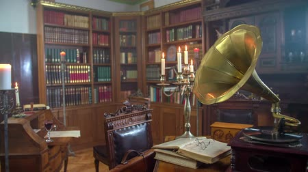 old times : Old wooden room in the vintage house full of historic books and gramophone, footage is taken in RAW. Stock Footage