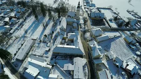 arrabaldes : Snow covered the village in the middle of a beautiful landscape, footage is taken from a helicopter camera.