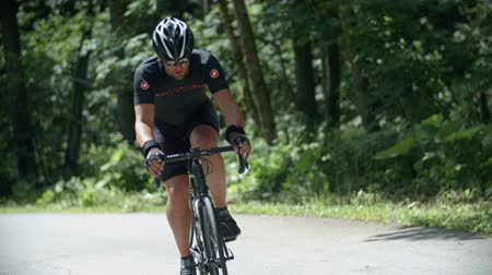 bisiklete binme : EVENT VRHNIKA JULY  2015: In this video you can see  the competitors during cycling through the forest in cycling marathon. Stok Video