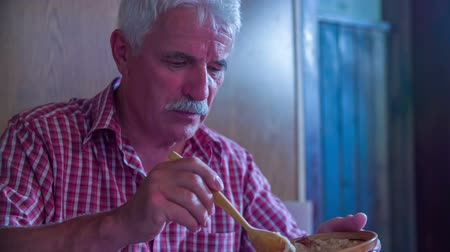 cracknel : An older man is serving himself some cabbage in an old-fashioned traditional restaurant. The whole place is decorated in this way. Wide-angle shot. Stock Footage
