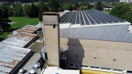 panel buildings : This is air view on part of school with solar panels which is on a beautiful location in the middle of nature which is placed in a beautiful environment on countryside.