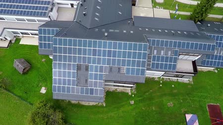 panel buildings : This is air view on big blue solar panels which is on a beautiful location in the middle of nature which is placed in a beautiful environment on countryside.