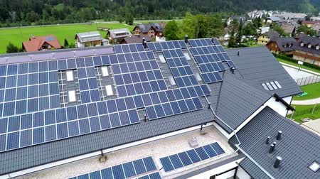 панель : Blue solar panels on school roof  is on a beautiful location in the middle of nature which is placed in a beautiful environment on countryside.