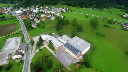 panel buildings : This is air view on countryside school with solar panels which is on a beautiful location in the middle of nature which is placed in a beautiful environment on countryside. Stock Footage