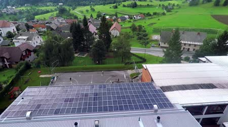 panel buildings : This is air view on building with solar panels which is standing on a beautiful location in the middle of nature which is placed in a beautiful environment on countryside. Stock Footage