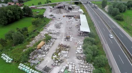 гражданский : EVENT LUKOVICA JUNE 2015: In this video, we can see a large construction site. Wide-angle shot taken from the sky. There is a highway next to it.