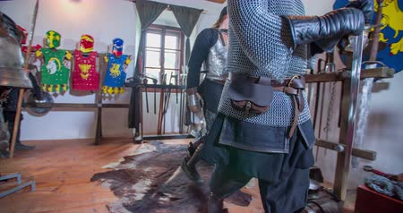 lovagi torna : Knights are taking spears and they are leaving the room and going to the battle. Close-up shot.