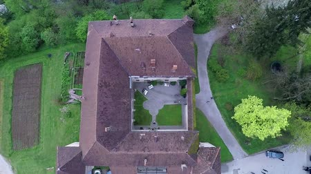 rycerz : There is a raised-relief map of a one part of the castle seen in this video. The castles roof is dark red or rather brown. Close-up aerial shot.