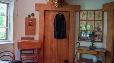 local de nascimento : A black coat is hanging on the closets door in one of the rooms at Plecnik House. Wide-angle shot. Stock Footage