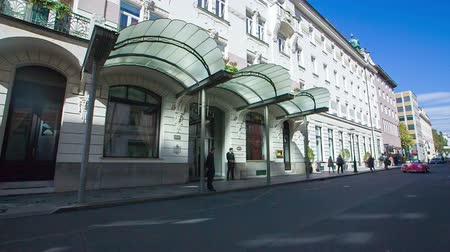 porters : EVENTS IN LJUBLJANA JULIJ-AVGUST 2016 A few porters are standing in front of the Grand Hotel Union hotel. It is summer time in Ljubljana. Wide-angle shot. Stock Footage