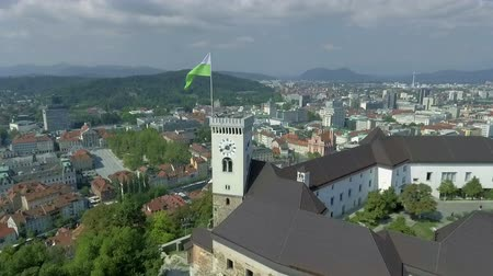 ljubljana : Ancient and oustanding part of the castle in the centre of Ljubljana, Slovenia. The tower boasts about famous flag with iconic green dragon.