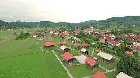 hay fields : View at first open-air hayrack museum in the world placed in small village Sentrupert in southern part of Slovenia. Stock Footage