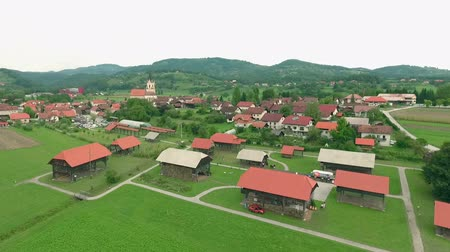 forest preservation : Small southern slovenian village Sentrupert with exibition of the first open-air hayrack museum in the world.