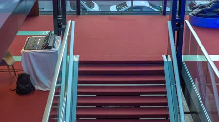 podium : Modern staircase in red carpet flooring surrounded with protective glass fence. Stock Footage