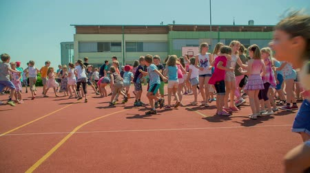 işe : GRIZE, SLOVENIA - 10. JUNE 2017  Children are running and playing catch me if you can. Its a nice summer day outside. Kids are having a lot of fun.