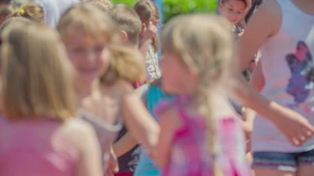 işe : GRIZE, SLOVENIA - 10. JUNE 2017  Small children are playing outside on the sport facility. They are having fun. Its summer time. Stok Video