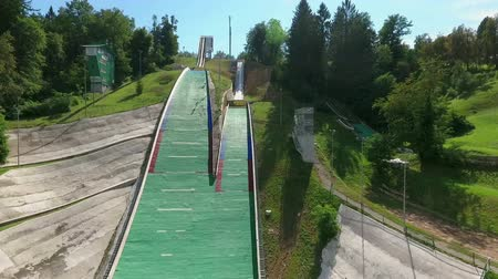 comes : Remarkable ski jumps for adrenaline freaks situated on a top of a hill in Velenje, Slovenia. Stock Footage
