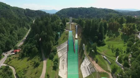 comes : Two amazing ski jumps situated on a hill and ready for active and extreme sportsmen. Stock Footage