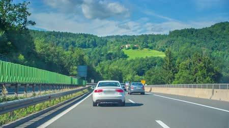 ljubljana : A car is driving on a fast line after another car. Its a nice sunny day in Slovenia.