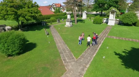 slovenya : ZALECCELJE, SLOVENIA - 18. MAY 2017 Everyone is gathered together and is listening to the guide speaking. This is taking place in the Roman necropolis.