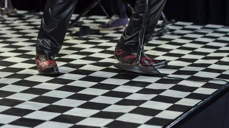 ゴージャス : Male singer in unusual boots performing on the stage and tapping his foot in rythm. 動画素材