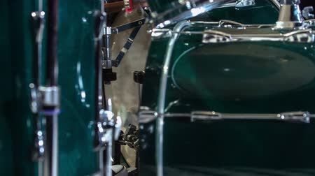 педаль : Drums in the foreground and drummers foot banging on the single bass drum pedal. Стоковые видеозаписи