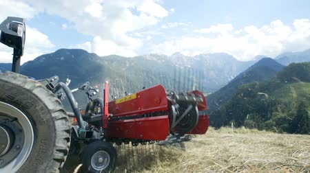 hay harvest : Rakes on the agricultural machinery are moving very fast when moving hay around. Stock Footage