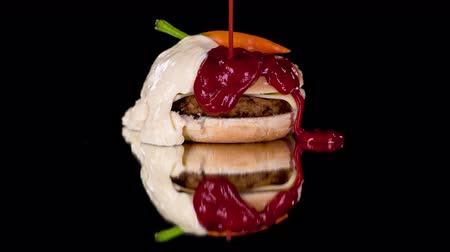 chilli sauce : Tasteful hamburger covered with seeds and red chilli and filled with chicken burger and sheep cheese poured with ketchup and white sauce.