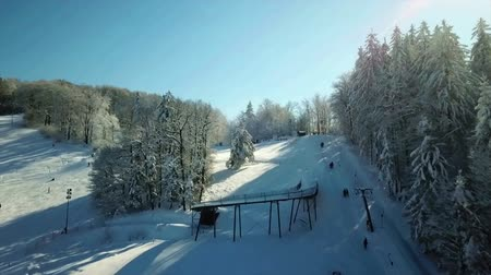 teljesen : A slide on the hill at Celjska koca resort is completely covered with snow. Its winter time. Aerial shot.