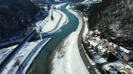 margem do rio : A beautiful blue river in winter time. There is still a lo of snow around. Aerial shot.