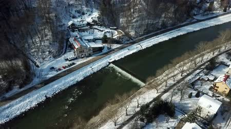 margem do rio : A river Savinja is peacefully flowing through a town of Celje. Its winter time. Aerial shot.