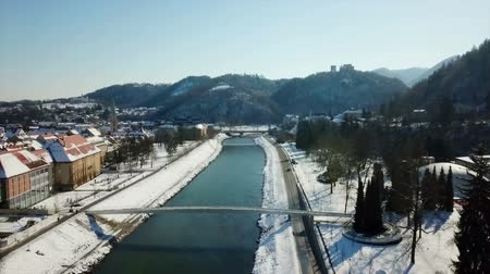 еще : Its winter time in Celje. We can see that snow is everywhere around. The day is clear yet cold.