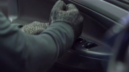 üveges : A mechanic is fixing the front door of a car. He is wearing safety gloves. Stock mozgókép