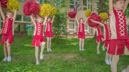 pom : Girls are really cute practising their routine for the school performance. Stock Footage