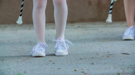 pom : Girls are stepping on one place and are practing their majorette routine. Stock Footage
