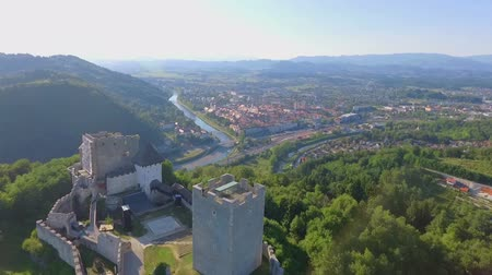 есть : Aerial shot of the castle standing on a hill. There is also a tower overlooking the town of Celje. Its a nice summer day.
