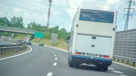 young elephants : A car is driving behind a bus on a highway somewhere close to the capital of Slovenia.