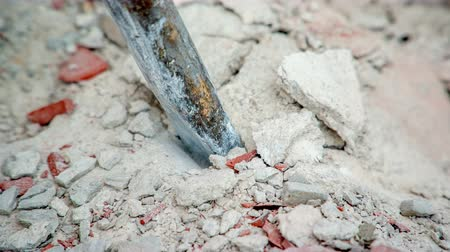 demolition : Chisel of jackhammer destroying solid concrete construction. It is working with intensive force.