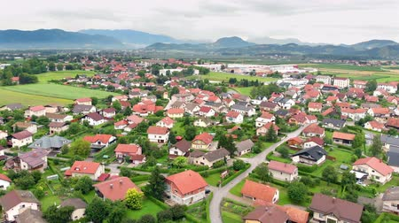 může : A very beautiful country of Slovenia. Everything is green. Aerial shot. We can also see mountains in the background.