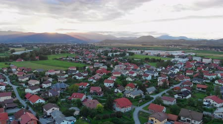 slovenya : Evening time is slowly coming into the village. Aerial shot. The sky is gorgeous.