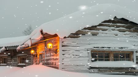 fülke : Entrance to a pretty snow-covered log cabin