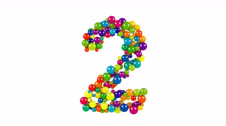Various sized green, red, blue and yellow balls in the shape of the number two over white background