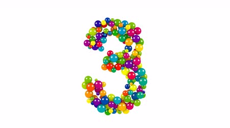 Various sized green, red, blue and yellow balls in the shape of the number three over white background Vídeos