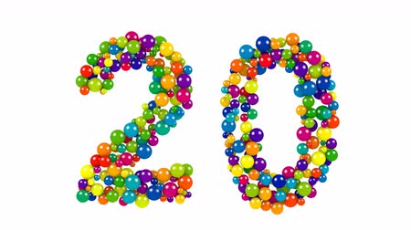Bright colored balls in the shape of number twenty Vídeos
